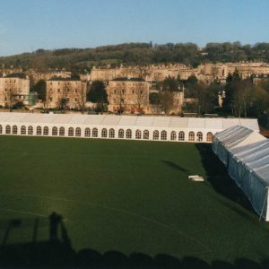 A very long white marquee in a field ready for the Bath Half Marathon