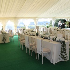 Inside a white wedding marquee at the master bride and groom table