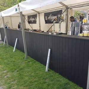 A marquee drinks bar
