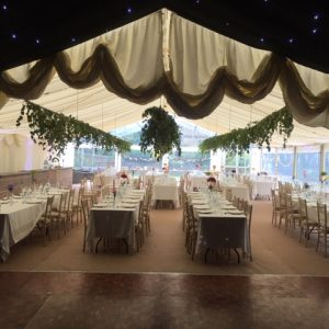 White marquee setup for a wedding reception