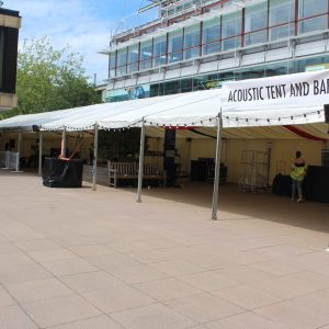 A bar marquee setup on a paved area in Bath