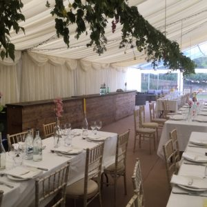 Inside a white marquee for a wedding reception